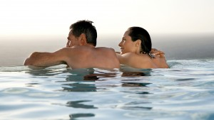 relaxing-couple-at-pool